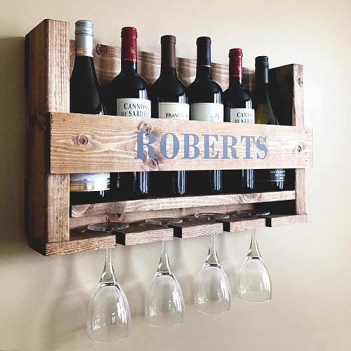 Wall mounted rustic wood wine rack, customized with his name