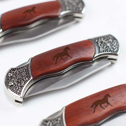 Engraved wooden pocket knife etched with horse