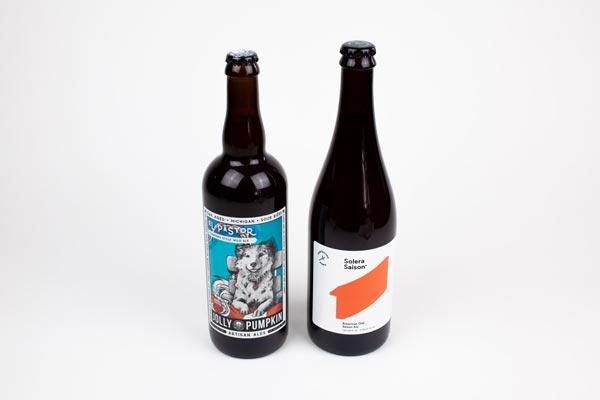 Two large artisan bottles of beer